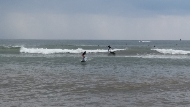 We both managed to stand up on the boards! I'm the one on the left.