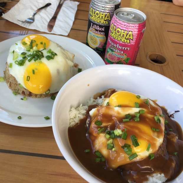 Pork fried rice and loco moco, a Hawaiian rice plate topped with a hamburger patty, fried egg, and gravy.