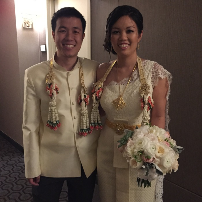 Bride and groom dressed in Thai wedding garb.